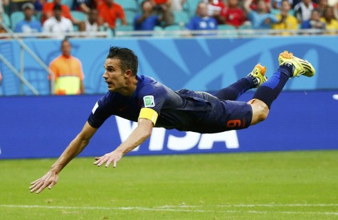 Robin van Persie of the Netherlands heads to score against Spain during their 2014 World Cup Group B soccer match at the Fonte Nova arena in Salvador