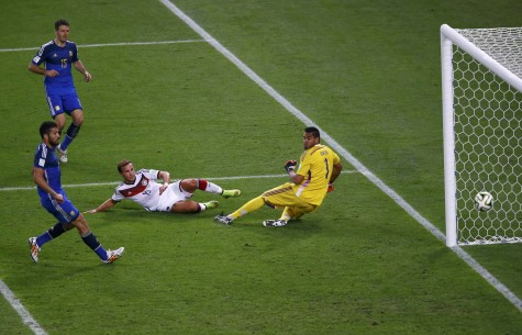 Germany's Goetze scores a goal past Argentina's Demichelis, Garay and goalkeeper Romero during extra time in their 2014 World Cup final at the Maracana stadium in Rio de Janeiro